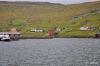 Wasserkraftwerk Heygaverkid vom Fjord Vestmanna betrachtet